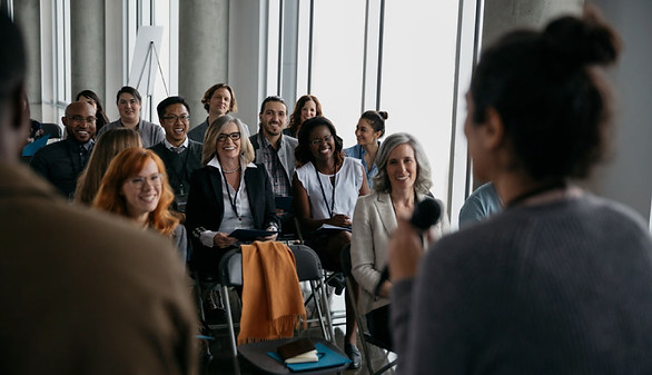 find photography networking events speaker talking to atendees