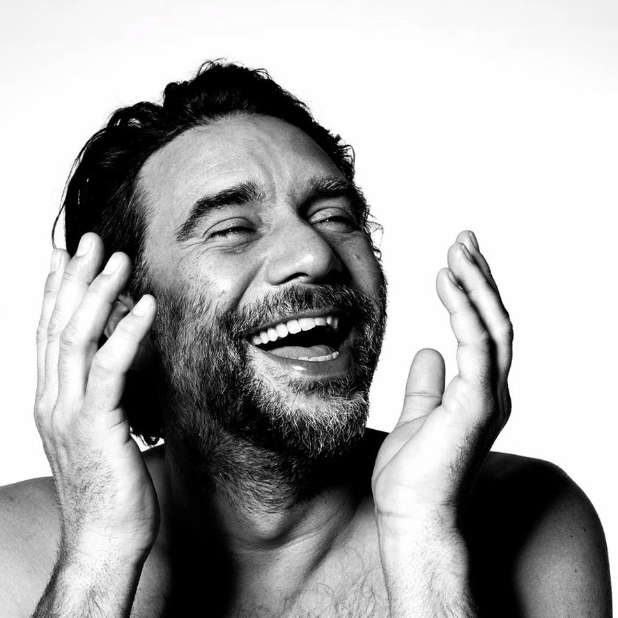 monochrome portrait of man laughing by Christel Mitchell