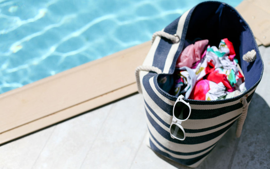 lifestyle product photography bag with clothes near pool