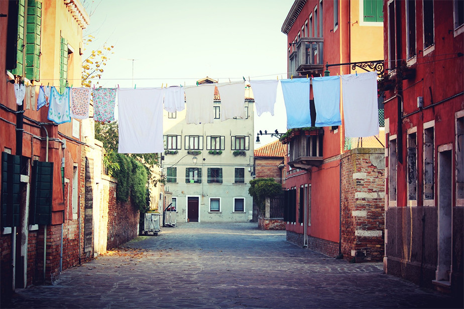 clothes hung on empty colorful street in the morning
