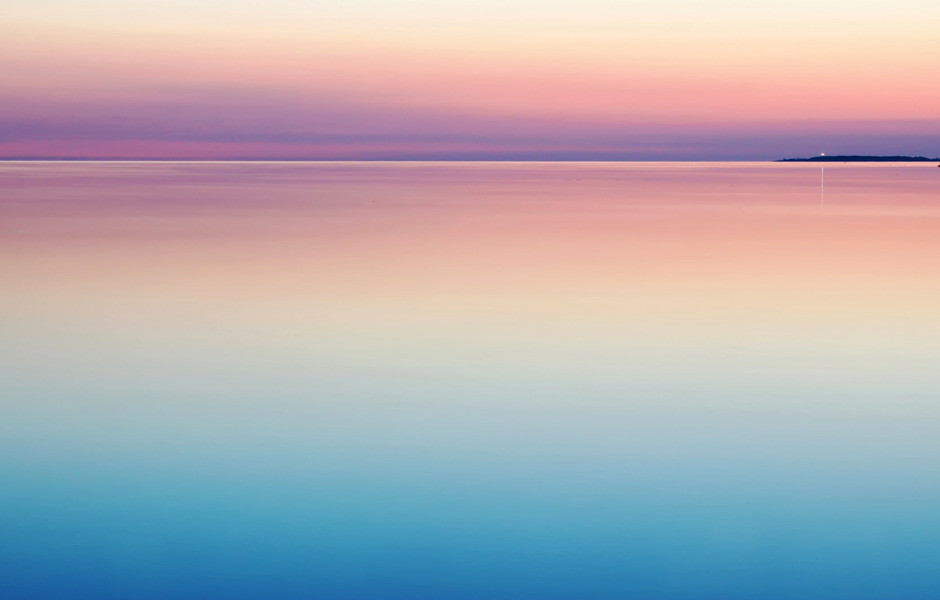 calm sea at sunset rule of thirds composition with color in photography