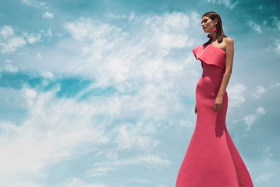woman in pink dress standing in front of blue sky by Alejandro Salinas