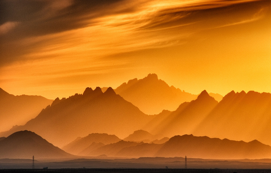 warm sunlight over mountains color theory photography golden hour