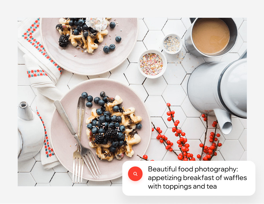 Appetizing breakfast of waffles with toppings and tea