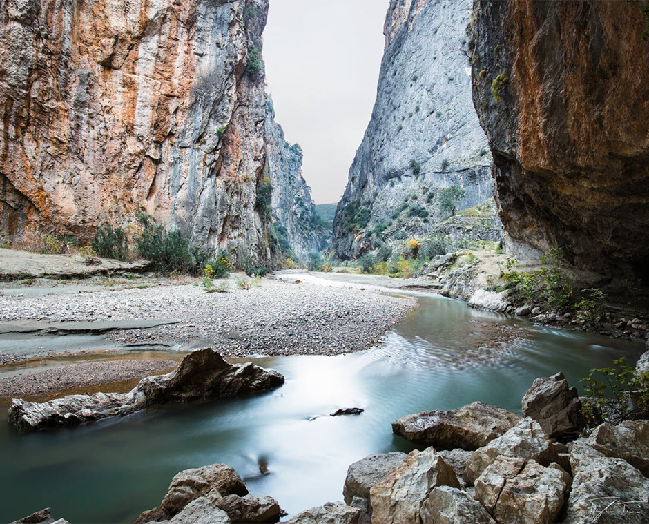 long exposure of river passing through canyon