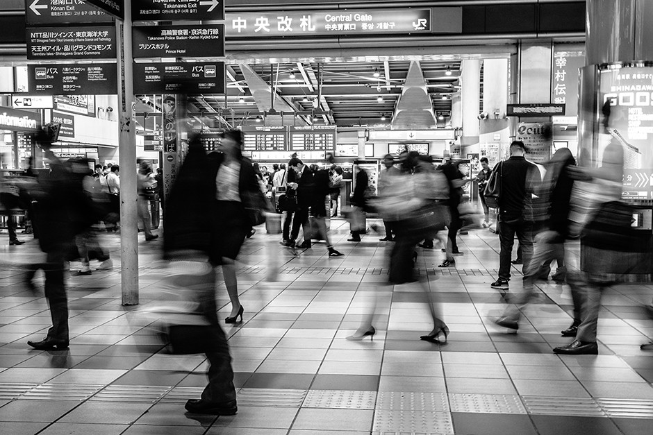 black and white long exposure photography people in train station