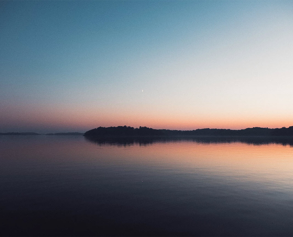 symmetric sunset over forest and lake