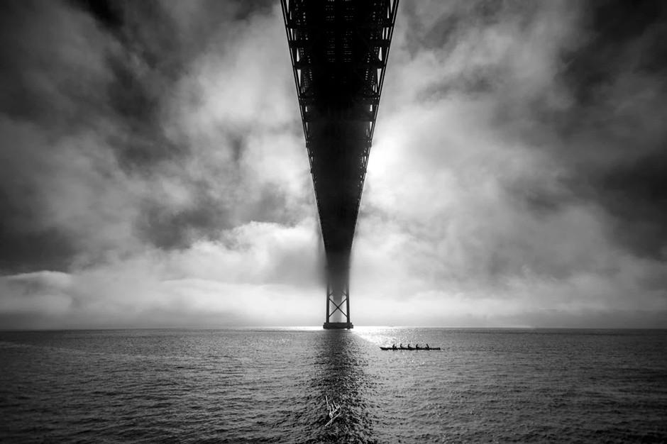 moody landscape of bridge crossing the sea