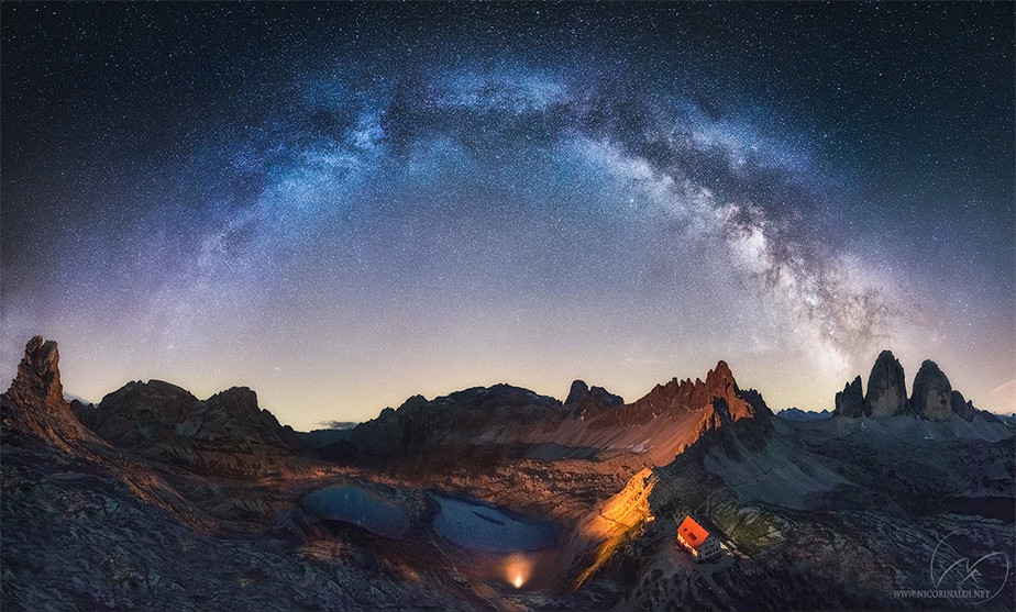 astrophotography milky way ark above mountains and lake