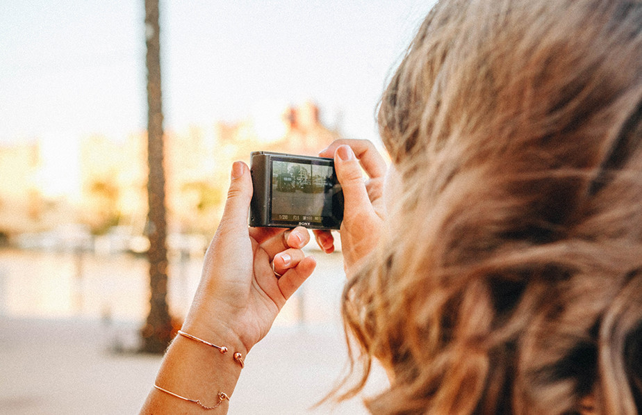 woman using compact camera
