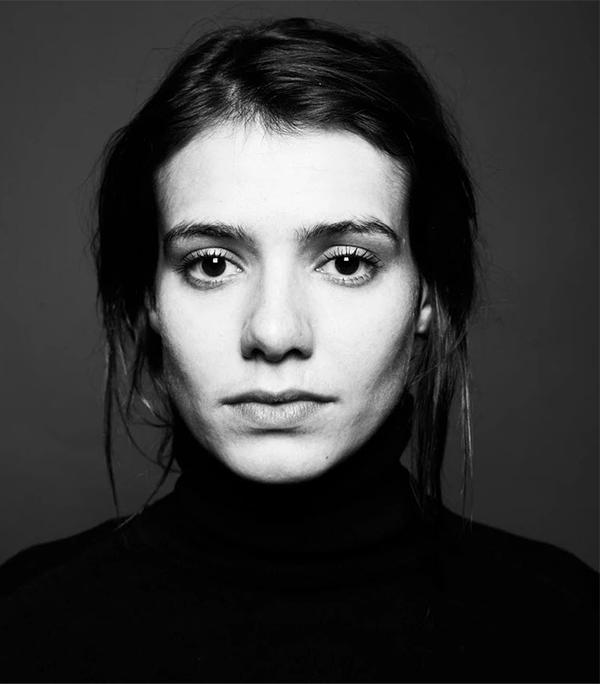 black and white headshot of brunette girl with long hair