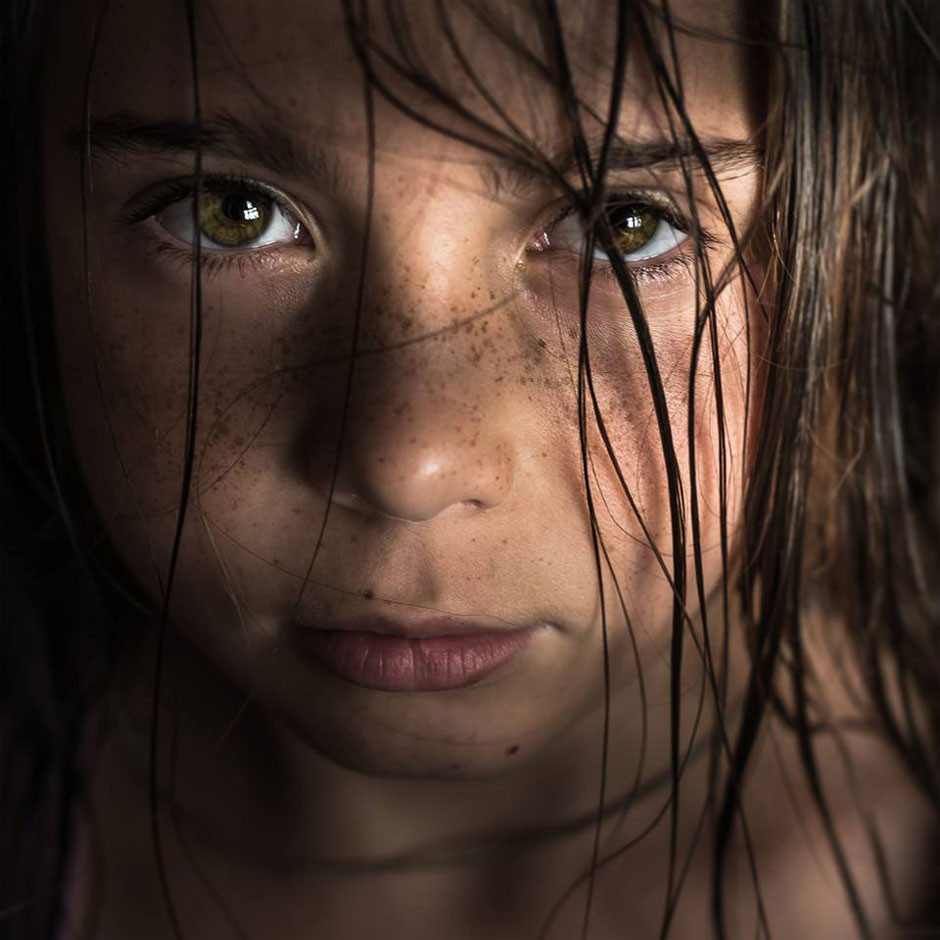 close-up portrait of young girl by Tomasz Solinski