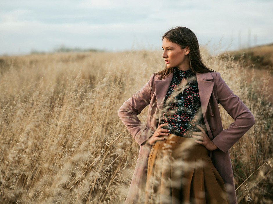 fashion photography girl standing in brown field