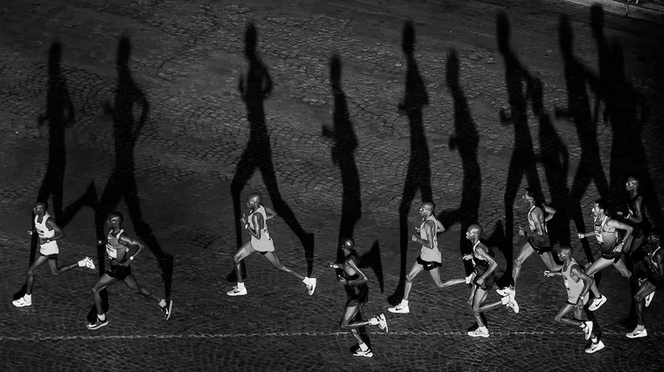 sports photography marathon runners and shadows on the ground