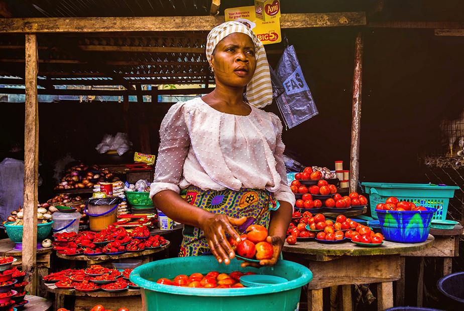 street photography portrait woman selling fruit