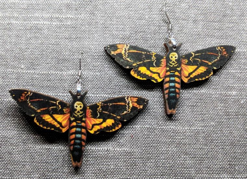 It puts the lotion on its skin moth earrings