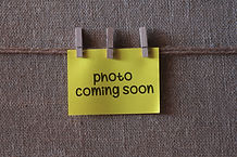 photo coming soon text on a yellow stick