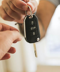 transponder key copy being passed to a person