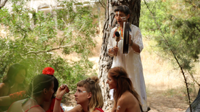 The women are painting their faces for a forest ceremony. Drumming by Aiwu Riviera