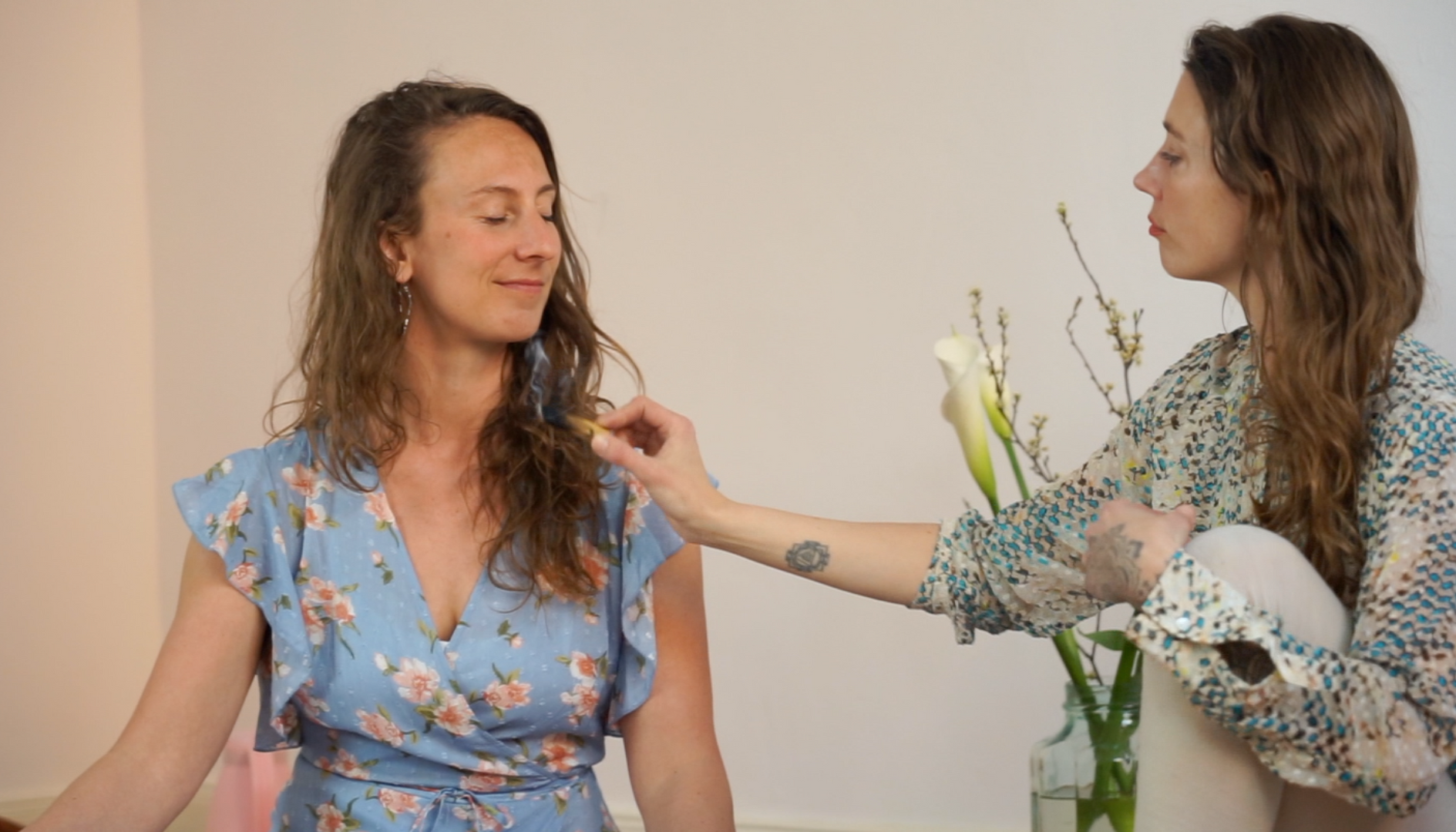 Julia smudging her friend Anna with Palo Santo