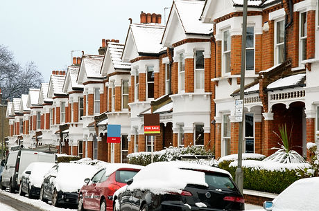 Snow covered Typical English Terraced Ho