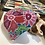 Thumbnail: אבן מקשוטת פרחים אדומים