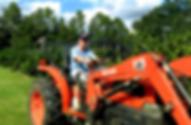 teenager driving satsuma tractor