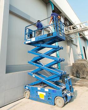 Builder on a Scissor Lift Platform at a