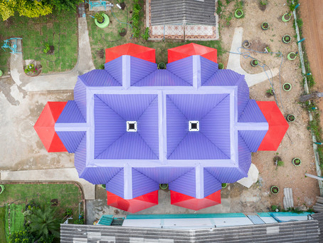 Brightly coloured classroom designed to harvest water in Thailand