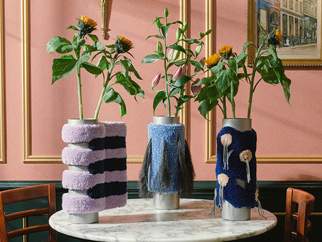 Steel and wool Cornucopia vases are designed to outshine the flowers they hold