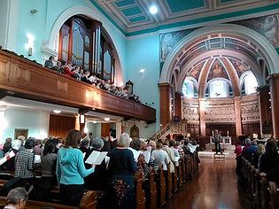 A packed church rehearsing Verdi Requiem
