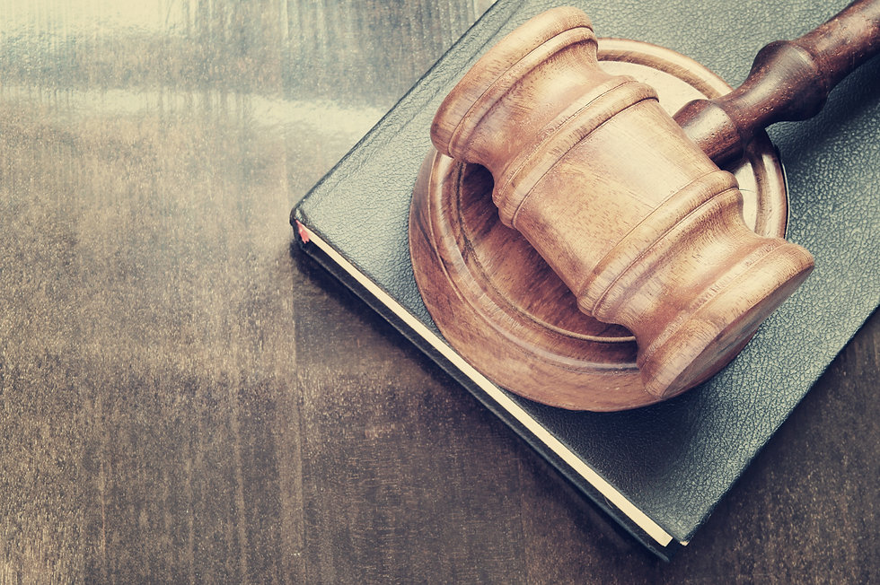 Judge gavel and legal book on wooden table.jpg