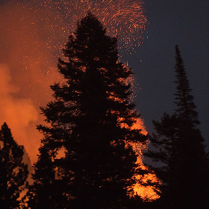 Embers float into the night sky during a wildfire.