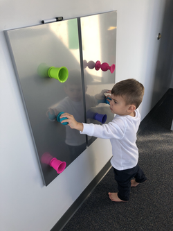 suction cups for crossing midline, eye hand coordination and strength