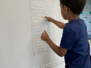 Why should kids work on a vertical surface?
