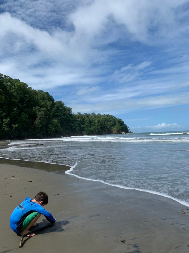 Boy on beach in Costa rica