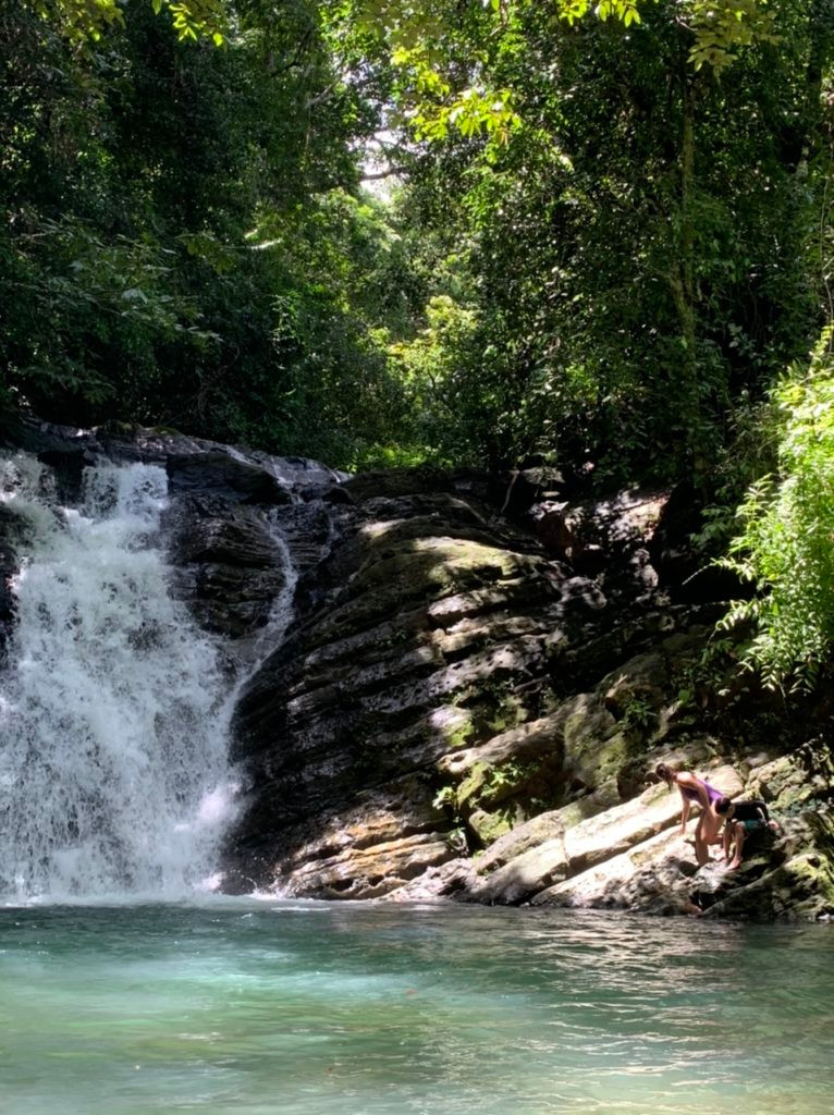 Diving from the rocks at Pozo Azul waterfall in Uvita Costa Rica