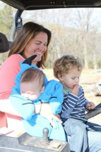 Mommy and her boys on the bobcat