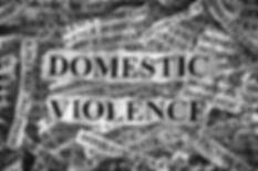 Domestic violence. Torn pieces of paper