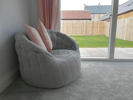 Barn-Conversion-Bedroom-Cozy-Chair.jpg
