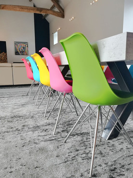 Barn-Conversion-Colourful-Chairs.jpg