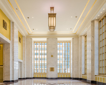 Gold tile and brass ornamentation pop against the white marble. Joni Kat Anderson Photography