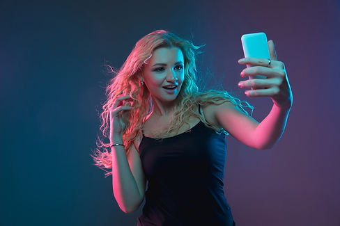 caucasian-young-woman-s-portrait-on-gradient-background-in-neon-light-beautiful-female-mod