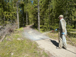 Road Oyl to preserve trail surfaces.