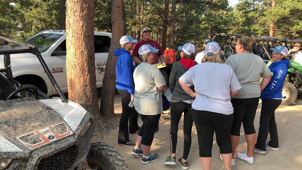 girls talking with Jesse (trail crew) from Backbone Adventures. Getting ready for some searious fun on ATV rentals in Estes Park Colorado