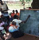 FAL Lady writing name on blackboard.jpg