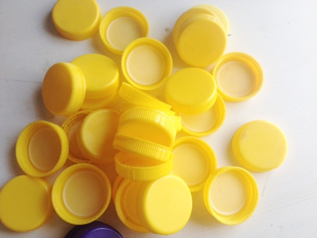 Gallon water bottle caps that can be used as counters in a classroom
