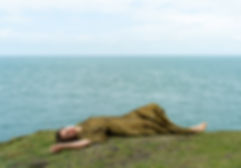 lying down shot by ocean.jpg