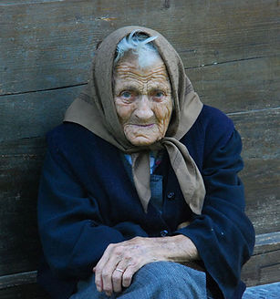 Old woman in coat and scarf