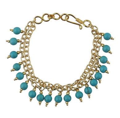 Goud met turquoise armband